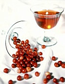 A Glass of Cranberries Spilling Over; Cranberry Juice