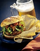 Hamburger with Lettuce and Salsa and Tortilla Chips
