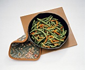 Sauteed Green Beans and Red Peppers in a Pan; Pot Holder