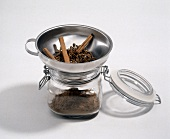 Assorted Spices in a Funnel with the Funnel in a Jar