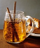 A Mug of Mulled Cider with Cinnamon Sticks