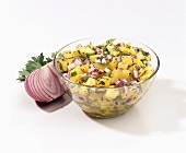 Pineapple Salsa in a Bowl with Red Onion