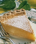 A Slice of Lemon Pie with Powdered Sugar