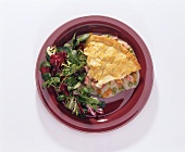 A Slice of Ham Pot Pie on a Plate with Salad