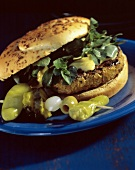 A Hamburger with Watercress and Mustard; Pepperoncinis