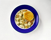 Chicken and Vegetable Soup in a Bowl with a Biscuit