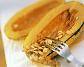 A Fork Removing Seeds from a Delicata Squash