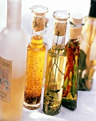 Assorted Oils in Glass Bottles; One in Plastic