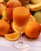 Fresh Multi Vitamin Juice in a Stem Glass; Assorted Fruit