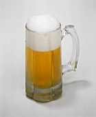 A Full Mug of Beer Foaming Over