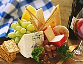 Assorted Cheese Crackers and Grapes; Wine