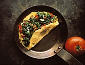 Spinach and Pimento Omelet in a Frying Pan