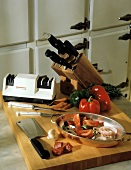Kitchen Knives and Knife Sharpener with Ingredients