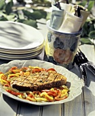 Grilled Swordfish with Peppers on an Outdoor Table