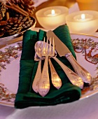 Holiday Place Setting with Burning Candles