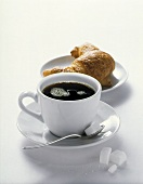 A Cup of Coffee with a Croissant