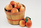Peaches in and Next to a Basket