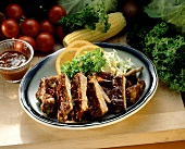 Barbecue Ribs on a Platter with an Orange Slice