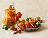 Fresh Assorted Tomatoes with a Bottle of Oil