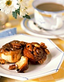 Two Sticky Buns On a Plate For Breakfast