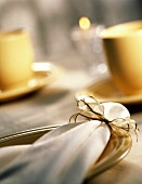 Holiday Place Setting; Cloth Napkin with Gold Ribbon
