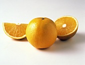 Whole Orange with Half an Orange and an Orange Wedge
