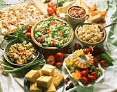 Buffet with Lasagna Assorted Salads Corn Bread and Beans Assorted Fruit