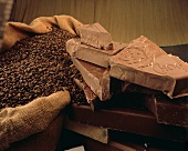 Coffee Beans in Sack and Chunks of Chocolate