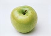 Ein gelb-grüner Apfel (Sorte Mutsu)