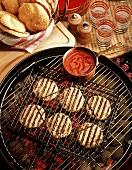 Grilling Chicken Burgers Over Hot Coals