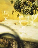Two Glasses of White Wine; Vase of Dried Flowers