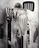 Stainless Steel Kitchen Tools in Soapy Water