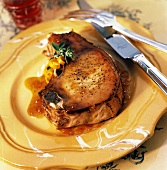 A Single Pork Chop with Orange Glaze