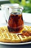 A Pitcher of Maple Syrup on Waffles