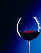 Glass of Red Wine with Blue Background