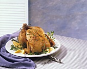 Roast Chicken with Fresh Herbs on a Platter; Corkscrew
