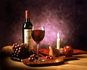 A Glass of Red Wine by Candlelight with Fruit