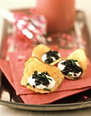 Potato Chips topped with Caviar and Sour Cream