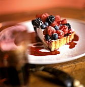 A Slice of Cream Cheese Torte Topped with Fresh Berries