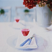 Table Setting with Glasses of Fruit Juice