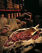 Burlap Bags of Dried Chili Peppers in a Warehouse