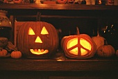 Two Jack O'Lanterns, One with a Peace Sign