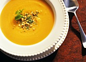 Sweet Potato Soup Topped with Crushed Peanuts and Mint