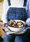 Woman Holding Shellfish Stew
