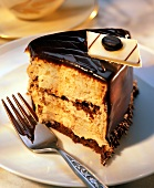 A Slice of Chocolate Frosted Layer Cake with Fork