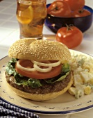Hamburger on a Sesame Bun with Potato Salad
