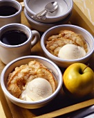 Two Bowls of Apple Crisp with Ice Cream and Coffee