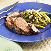 Sliced Grilled Butterflied Leg of Lamb with Roasted Green Beans