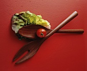 Salad Utensils with Lettuce Leaf and Tomato