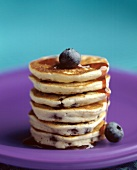 A Stack of Mini Blueberry Pancakes with Syrup